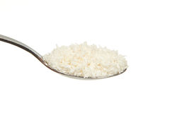 Coconut flour on a teaspoon Royalty Free Stock Image