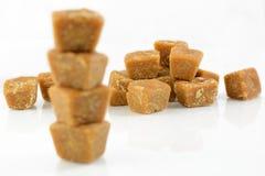Coconut flower sugar. Stacking coconut flower sugar blocks on white background stock image