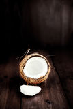 Coconut fruit  cut in half with pieces / close up of a coconut o Stock Photography