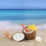 Coconut fruits cocktail drink in summer on the beach Royalty Free Stock Images