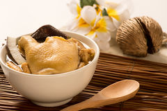 Coconut with Ginseng and Lily Bulb Soup with chicken on bamboo t Royalty Free Stock Image