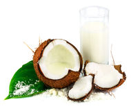 Coconut with glass of coconut milk and green leaf Stock Image