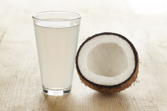 Coconut with a glass of coconut water. Coconut with a glass of fresh coconut water Royalty Free Stock Images