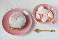 Coconut Glazed Donut and Coffee with Marshmallows. Coconut Glazed Donut with a Paper Heart on a Stick and Coffee with Marshmallows Royalty Free Stock Image