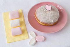 Coconut Glazed Donut with Marshmallows. Coconut Glazed Donut with a Paper Heart on a Stick and Marshmallows Stock Image