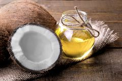 Coconut with coconut oil on a brown wooden background stock image