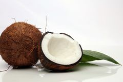 Coconut with half and leaves on white background. Coconut with half and leaves on white background Stock Photo