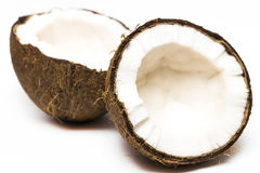 Coconut with a half on white background, closeup.  Stock Photos