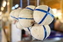 Coconut hanging display at fresh market royalty free stock photo