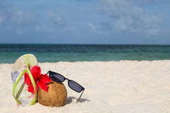 Coconut, hibiscus flower, sunglasses and flip flops Stock Image