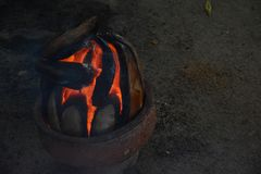 Coconut husks in fire. Coconut husks are set on fire, so that their smoke can help chase away mosquitoes Royalty Free Stock Images