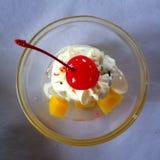 Coconut ice cream. Coconut and cherry ice cream Royalty Free Stock Photo