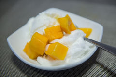 Coconut ice cream with fresh mango Stock Photos