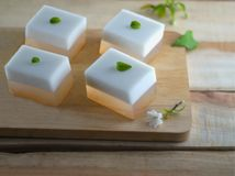Coconut jelly on wooden dish royalty free stock photography