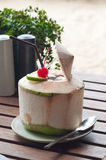Coconut juice. The coconut juice and cherry for refreshing you in the summer Stock Photo
