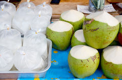 Coconut juice and coconut water packing thai style for sale Stock Image