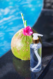 Coconut juice drink with flower and bottle of oil Royalty Free Stock Photos
