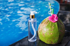 Coconut juice drink with flower and bottle of oil Royalty Free Stock Images