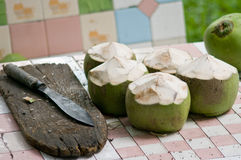 Coconut with knife Royalty Free Stock Images