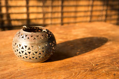 Coconut lantern on wooden table agent sunlight Stock Photography