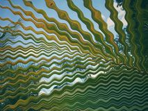 Coconut leaf distorted in the form of waves. Forming a beautiful abstract image and psychedelic, and it can represent distortions of reality Stock Image