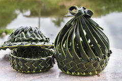 Coconut leaves basket and hat Stock Photos