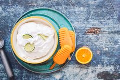 Coconut lime sorbet and orange popsicles with fresh fruits. Coconut lime sorbet in bowl and orange popsicles with fresh fruits on plate Royalty Free Stock Photos