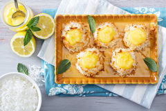 Coconut macaroon cookies with lemon curd Royalty Free Stock Image
