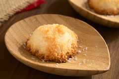 Coconut Macaroon. Homemade coconut macaroon (coconut meringue cookie), traditional Christmas cookie in Germany called Kokosmakrone, photographed with natural Royalty Free Stock Image