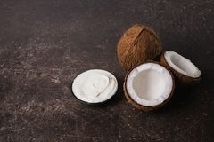 The coconut is on the marble table. royalty free stock image