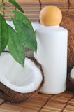 Coconut and massage oil. For body on straw napkin stock photo
