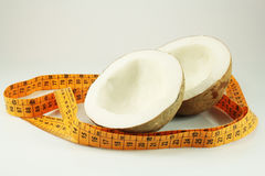 Coconut and measuring tape Stock Images