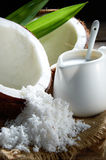 Coconut Milk. With mood lighting on wooden background stock photography
