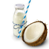 Coconut milk in the bank against the backdrop of coconut. Isolat Stock Photography
