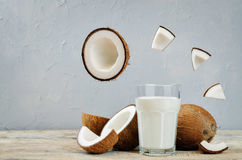 Coconut milk with coconuts and flying slices Royalty Free Stock Image