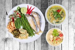Coconut milk and fermented soy bean sauce and green curry with s. Ide dish as deep fired mackarels,omelet,crispy pork rind,halve green lemon,red chili and boiled stock photos