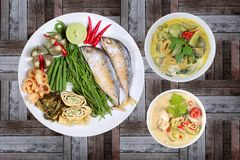 Coconut milk and fermented soy bean sauce and green curry with s. Ide dish as deep fired mackarels,omelet,crispy pork rind,halve green lemon,red chili and boiled stock image
