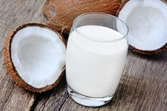 Coconut milk in a glass on rustic table Stock Image