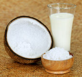 Coconut with milk and grated form Royalty Free Stock Images