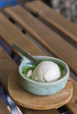 Coconut milk ice cream in bowl painted turquoise on wood slat -. Table background stock images