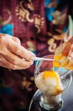 Coconut milk ice cream with creamy egg yolk, tradition sweet dessert cuisine of Songkhla old town. Thailand stock photos