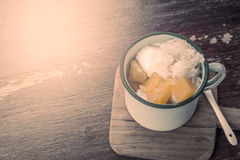 Coconut milk ice cream with sticky rice and yam in old glass Stock Photos
