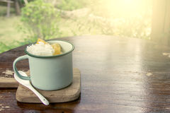 Coconut milk ice cream with sticky rice and yam in old glass Stock Image