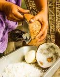 Coconut milk making. Stock Photo