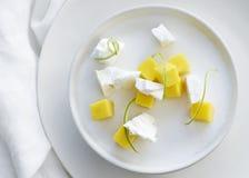 Coconut milk pannacotta with crispy meringue lime mango on white Stock Photography