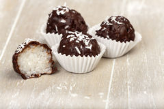 Coconut milk rice truffles with shredded coconut Royalty Free Stock Photo
