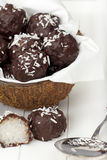 Coconut milk rice truffles with silver spoon Royalty Free Stock Images