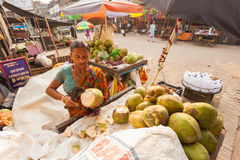 Coconut milk seller Stock Images