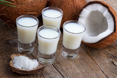 Coconut milk and shells Stock Photo