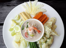 Coconut milk simmer shrimp stew. Focusing top view of coconut milk simmer shrimp stew, The famous royal traditional Thai`s style dipping menu served with mixed Royalty Free Stock Photo
